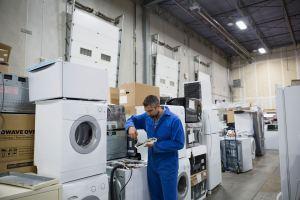 img-erp-org-worker-repairing-appliances-in-workshop-664658417