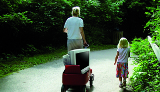 Image: Mother and Kid carrying an old Tv